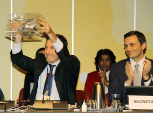 Fernando Lugris, chair of the INC mercury negotiations holds up Pez-Peste