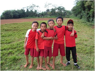 Children on toxic soccer field in Indonesia